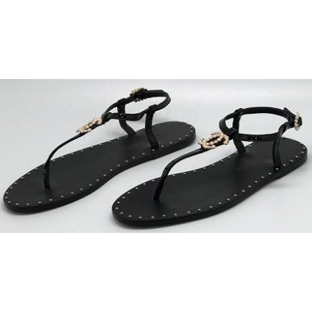 Женские брендовые кожаные сандалии Chanel Cruise черные на плоской подошве